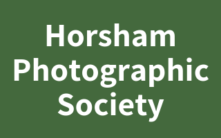 "Mr N (Horsham) supporting <a href=""support/horsham-photographic-society"">Horsham Photographic Society</a> matched 2 numbers and won 3 extra tickets"